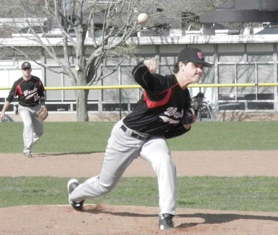 Fairfield Warde sophomore pitcher Reece Maniscalco sends a pitch toward a Norwalk batter on Wednesday, April 23 in an FCIAC baseball game in Fairfield. The Mustangs won 10-1. Maniscalco gave up three hits in six innings, and struck out six Bears. Photo: Reid L. Walmark / Fairfield Citizen
