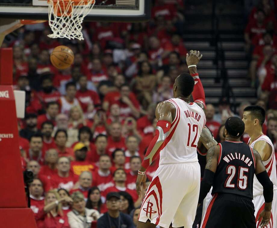 Rockets center Dwight Howard  watches his free throw drop. Photo: James Nielsen, Houston Chronicle