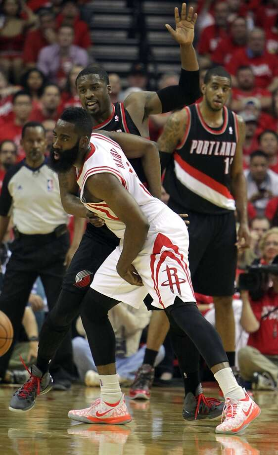 Rockets guard James Harden left, and Trail Blazers guard Wesley Matthews tangle. Photo: James Nielsen, Houston Chronicle