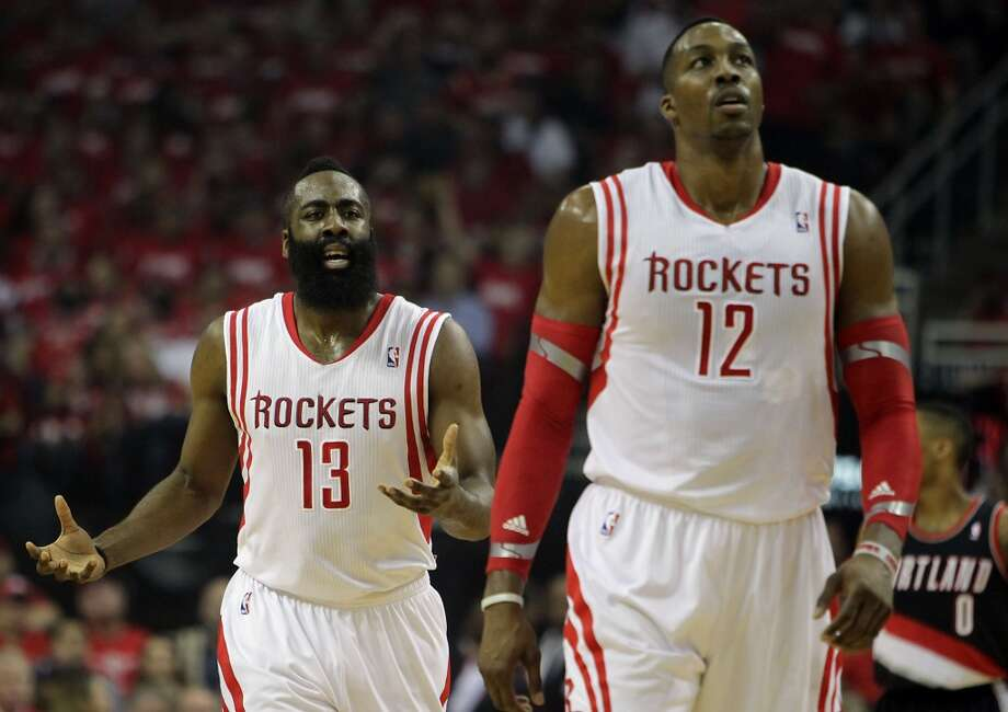 Rockets guard James Harden left, disputes a call. Photo: James Nielsen, Houston Chronicle