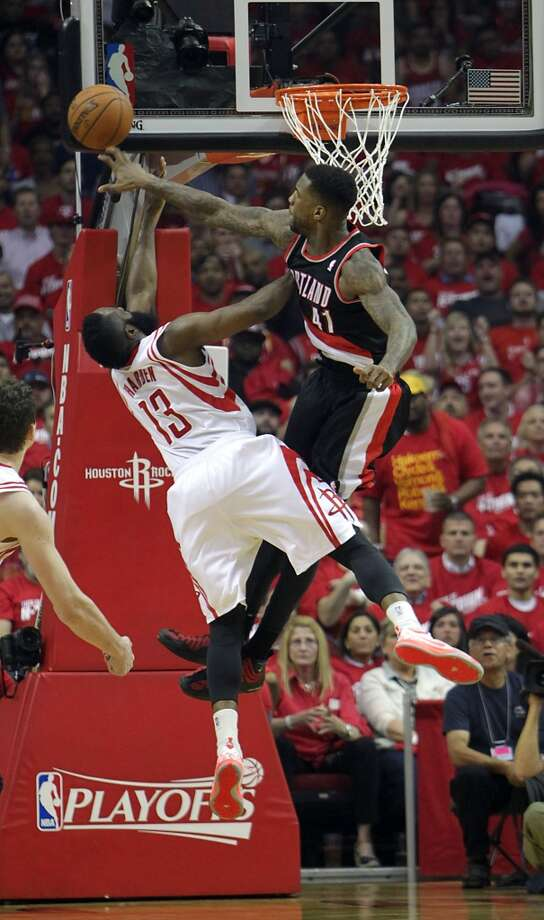Trail Blazers forward Thomas Robinson right, blocks a shot by Rockets guard James Harden . Photo: James Nielsen, Houston Chronicle