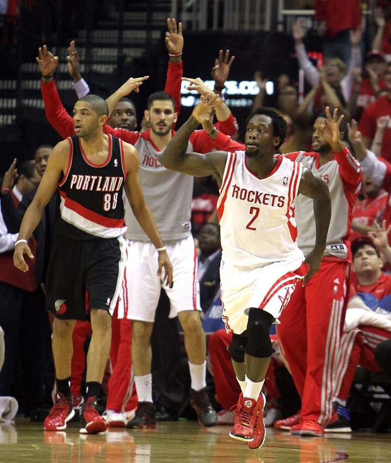 Rockets guard Patrick Beverley  gestures after scoring a basket. Photo: James Nielsen, Houston Chronicle