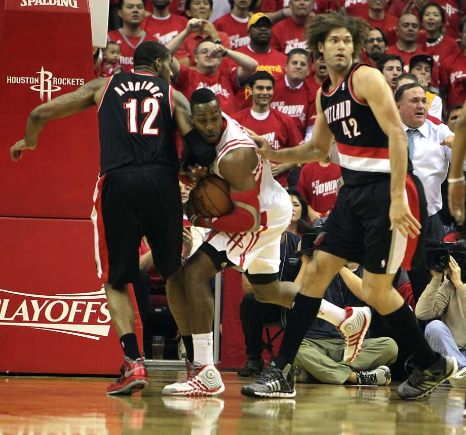 Rockets center Dwight Howard  2nd from right, fouls Trail Blazers forward LaMarcus Aldridge. Photo: James Nielsen, Houston Chronicle