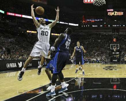 Spurs' Manu Ginobili (20) loses the ball against Dallas Mavericks' DeJuan Blair (45) in the first half of Game 2 of the first round of the Western Conference playoffs at the AT&T Center on Wednesday, Apr. 23, 2014. (Kin Man Hui/San Antonio Express-News) Photo: Kin Man Hui/San Antonio Express-News