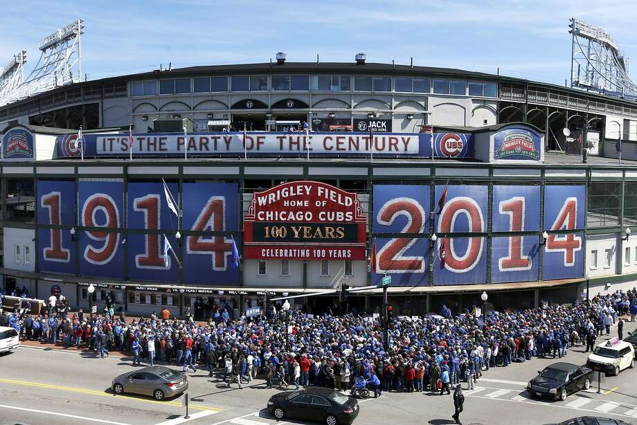 Fans wait to enter Wrigley Field in Chicago on April 23, the 100th anniversary of the first baseball game at the ballpark, before a game between the Diamondbacks and Cubs. Photo: Charles Rex Arbogast, Associated Press