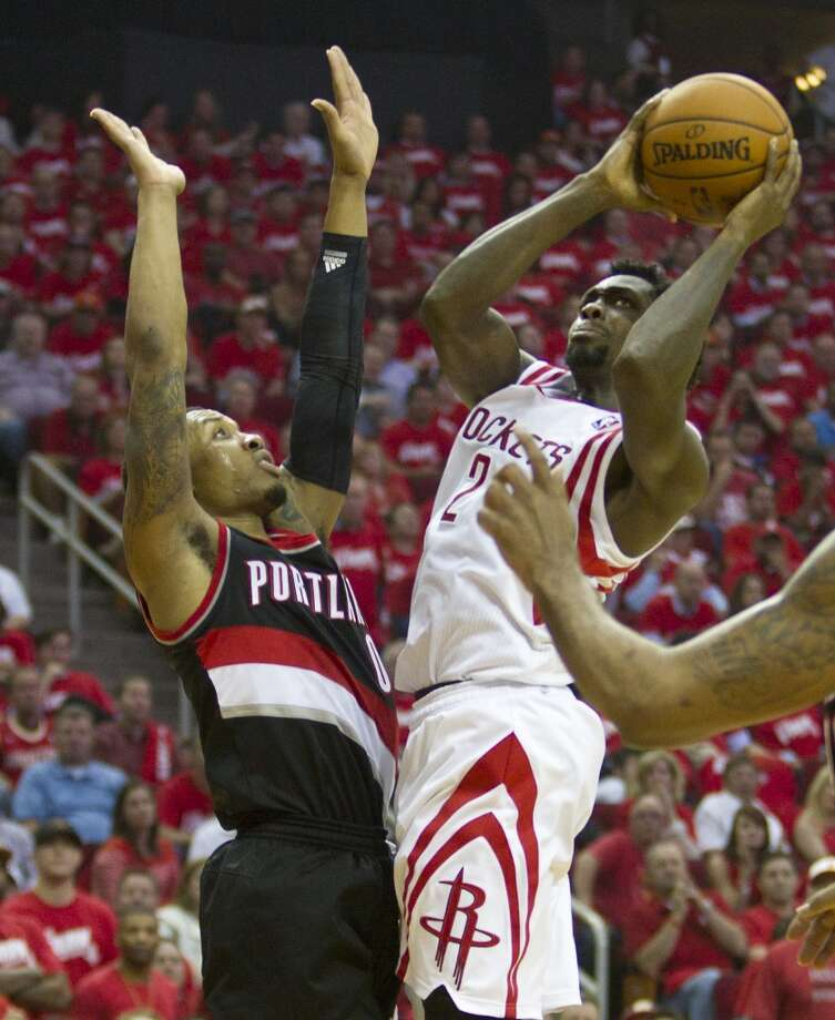 Portland Trail Blazers guard Wesley Matthews (2) goes up for a shot against Portland Trail Blazers guard Damian Lillard (0) during the second quarter of Game 2 of the NBA Western Conference Quarterfinals at Toyota Center Wednesday, April 23, 2014, in Houston. ( Brett Coomer / Houston Chronicle ) Photo: Brett Coomer, Houston Chronicle