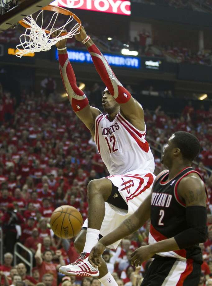 Houston Rockets center Dwight Howard (12) dunks over Portland Trail Blazers guard Wesley Matthews (2) during the second quarter of Game 2 of the NBA Western Conference Quarterfinals at Toyota Center Wednesday, April 23, 2014, in Houston. ( Brett Coomer / Houston Chronicle ) Photo: Brett Coomer, Houston Chronicle