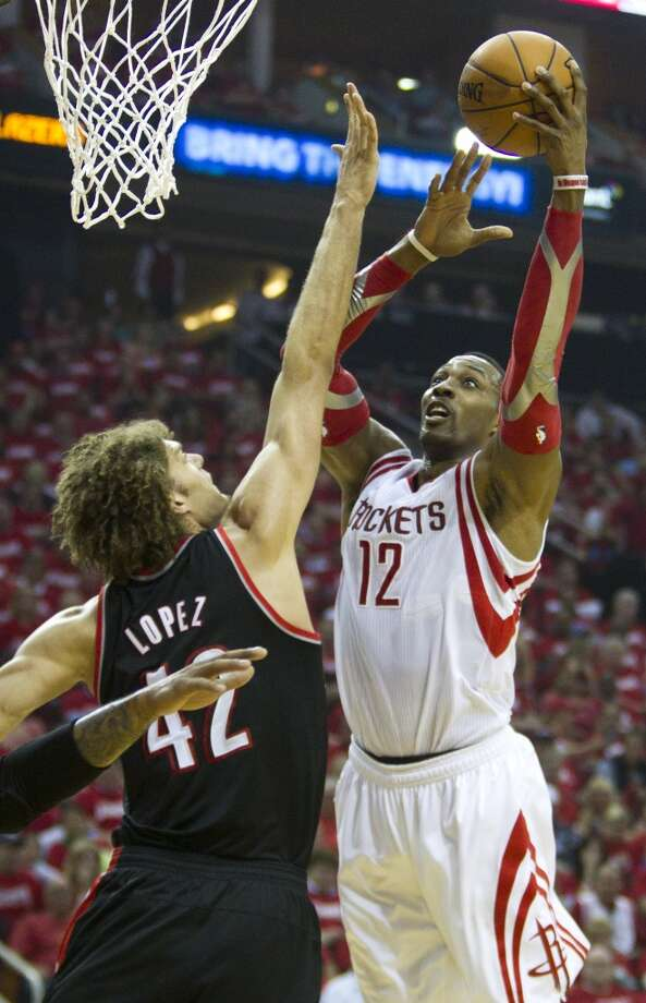 Houston Rockets center Dwight Howard (12) shoots over Portland Trail Blazers center Robin Lopez (42) during the second quarter of Game 2 of the NBA Western Conference Quarterfinals at Toyota Center Wednesday, April 23, 2014, in Houston. ( Brett Coomer / Houston Chronicle ) Photo: Brett Coomer, Houston Chronicle