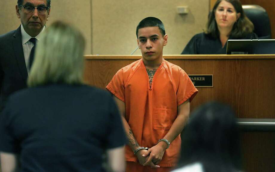 John Gonzales III (center), 17, was sentenced to the maximum 20 years on murder charges related to the gunshot killing of James Whitley in August 2012. Photo: Bob Owen / San Antonio Express-News / © 2012 San Antonio Express-News