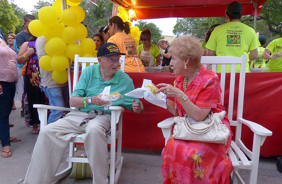 Richard A. Loring and his bride of 59 years, Ruthie Loring, enjoy corn during the annual Taste of the Northside, a food-friendly event at the parking lot of The Club at Sonterra. Photo: Photos By Billy Calzada / San Antonio Express-News / San Antonio Express-News