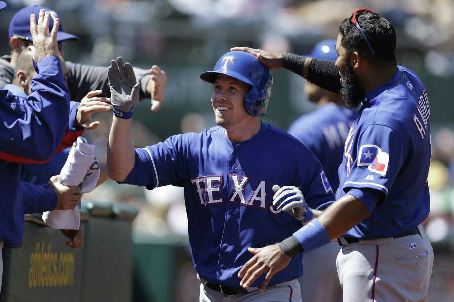Donnie Murphy (center) hit a homer in the sixth inning to back Martin Perez in the Rangers' victory. Photo: Ben Margot / Associated Press / AP