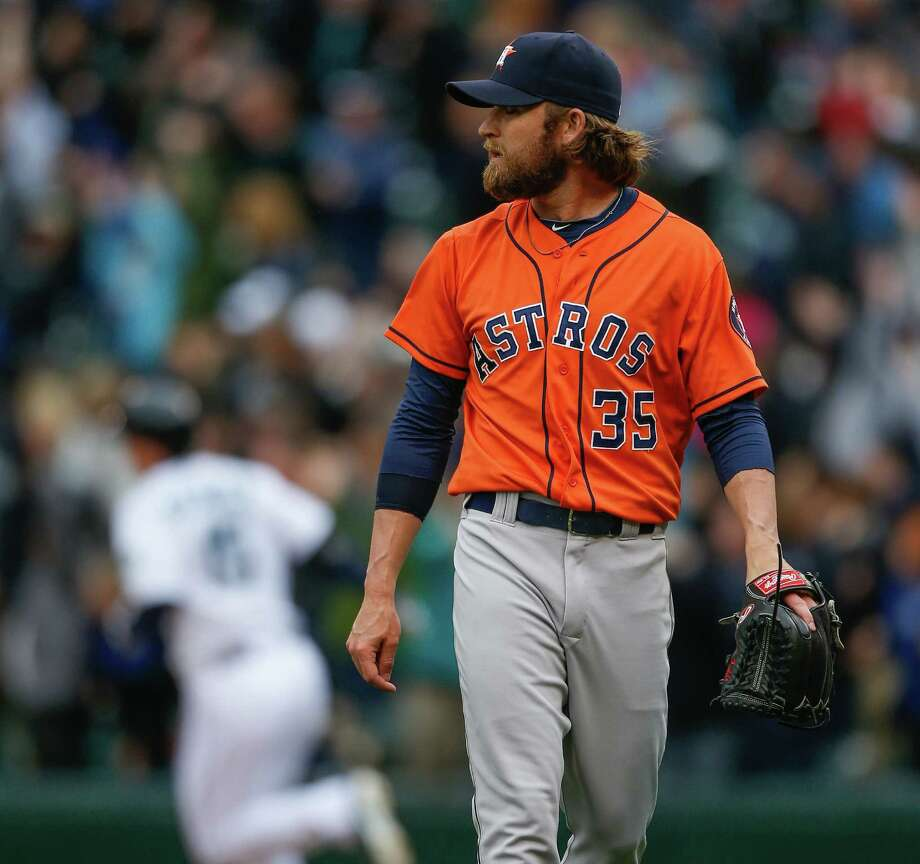 Astros reliever Josh Fields walks away after giving up the game-winning homer Wednesday in Seattle. Photo: Otto Greule Jr. / Getty Images / 2014 Getty Images