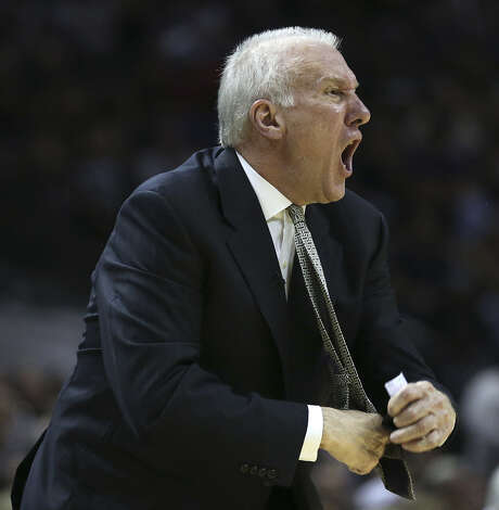 Spurs coach Gregg Popovich yells toward officials during the first half of the Game 2 loss. Photo: Jerry Lara / Express-News / ©2014 San Antonio Express-News