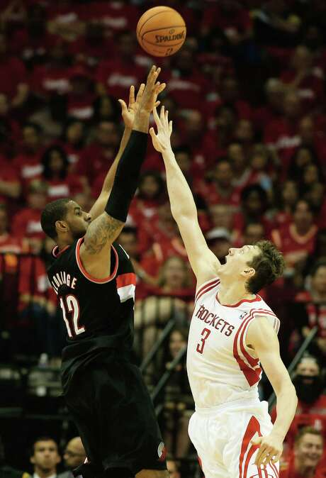 Omer Asik (right) and the rest of Houston could do little to stop Portland's LaMarcus Aldridge, who had 43 points. Photo: Mike Ehrmann / Getty Images / 2014 Getty Images