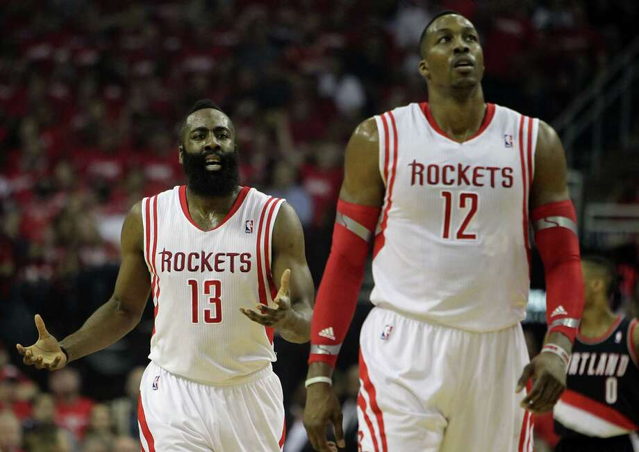 Rockets guard James Harden, left, and center Dwight Howard have been outplayed by Blazers counterparts Damian Lillard and LaMarcus Aldridge in the first two games of their Western Conference series. Photo: James Nielsen, Staff / © 2014  Houston Chronicle