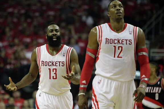 Rockets guard James Harden, left, and center Dwight Howard have been outplayed by Blazers counterparts Damian Lillard and LaMarcus Aldridge in the first two games of their Western Conference series.