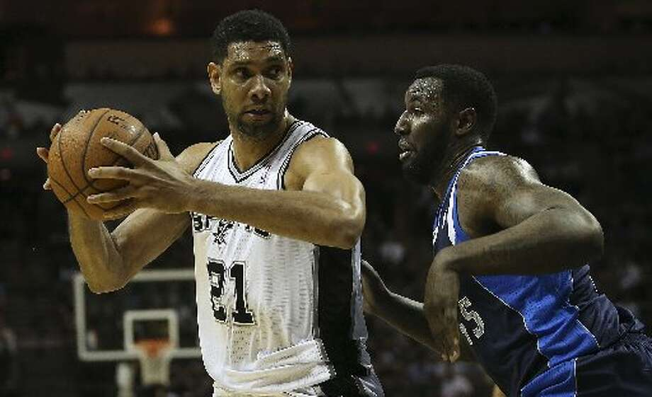 San Antonio Spurs' Tim Duncan drives around Dallas Mavericks' DeJuan Blair during the first half of game two in the first round of the Western Conference Playoffs at the AT&T Center, Wednesday, April 23, 2014. Photo: Jerry Lara/San Antonio Express-News