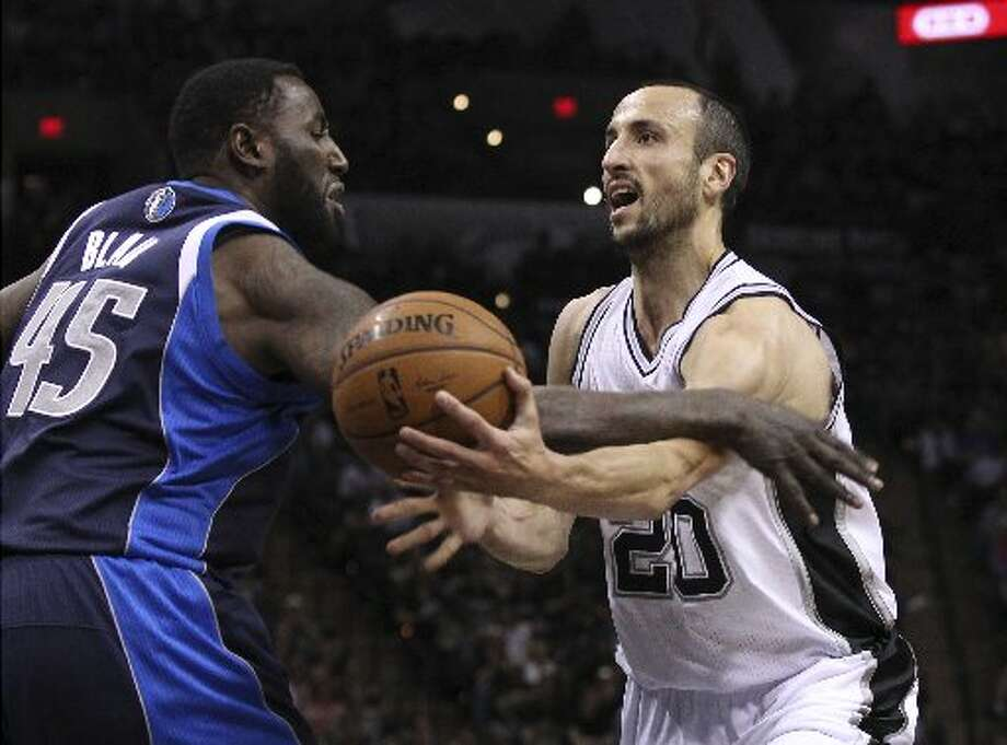 Spurs' Manu Ginobili (20) gets a hard foul from Dallas Mavericks' DeJuan Blair (45) in the second half of Game 2 of the first round of the Western Conference playoffs at the AT&T Center on Wednesday, Apr. 23, 2014. Mavs defeated the Spurs, 113-92. (Kin Man Hui/San Antonio Express-News) Photo: Kin Man Hui/San Antonio Express-News