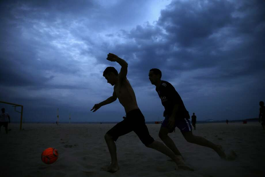 Brazilians and tourists play soccer on Copacabana beach, in Rio de Janeiro, Brazil, Wednesday, April 23, 2014. With the World Cup weeks away, Brazil has been struggling to get the country ready for the World Cup. Infrastructure work is far from completed and violent clashes continue to flare up in several cities. (AP Photo/Hassan Ammar) Photo: Hassan Ammar, Associated Press