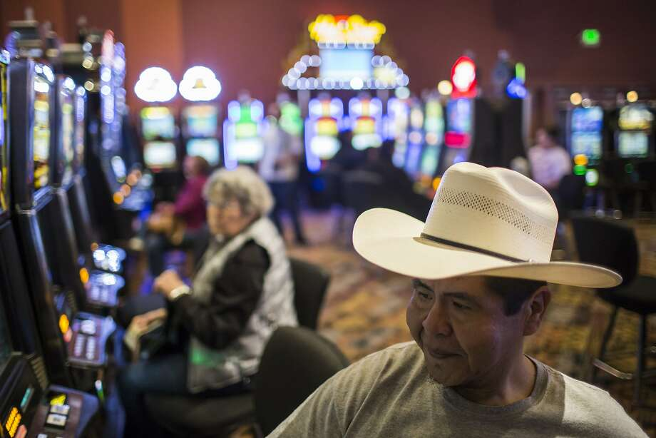 """We haven't had a vacation in years,"" said Overton Sankey, whose wife is a tribal member, on Wednesday, April 23, 2014, at the Wind River Hotel and Casino in Riverton, Wyo. Members of the Northern Arapaho tribe began receiving checks today from a $157 million dollar settlement stemming from a 1970's lawsuit concerning mineral rights on the Wind River Indian Reservation. Sakey and his wife plan on using the money to travel to the 31st Gathering of Nations Pow Wow in Albuquerque this weekend, as well as making some improvements to their home. Each tribal member was slated to receive $6,300. (AP Photo/Casper Star-Tribune, Ryan Dorgan) Photo: Ryan Dorgan, Associated Press"