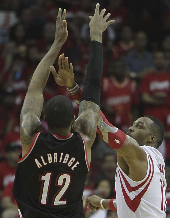 Trail Blazers forward LaMarcus Aldridge  and Rockets center Dwight Howard. Photo: James Nielsen, Houston Chronicle