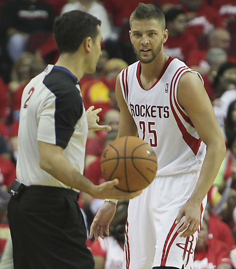 Rockets forward Chandler Parsons  speaks with an official. Photo: James Nielsen, Houston Chronicle