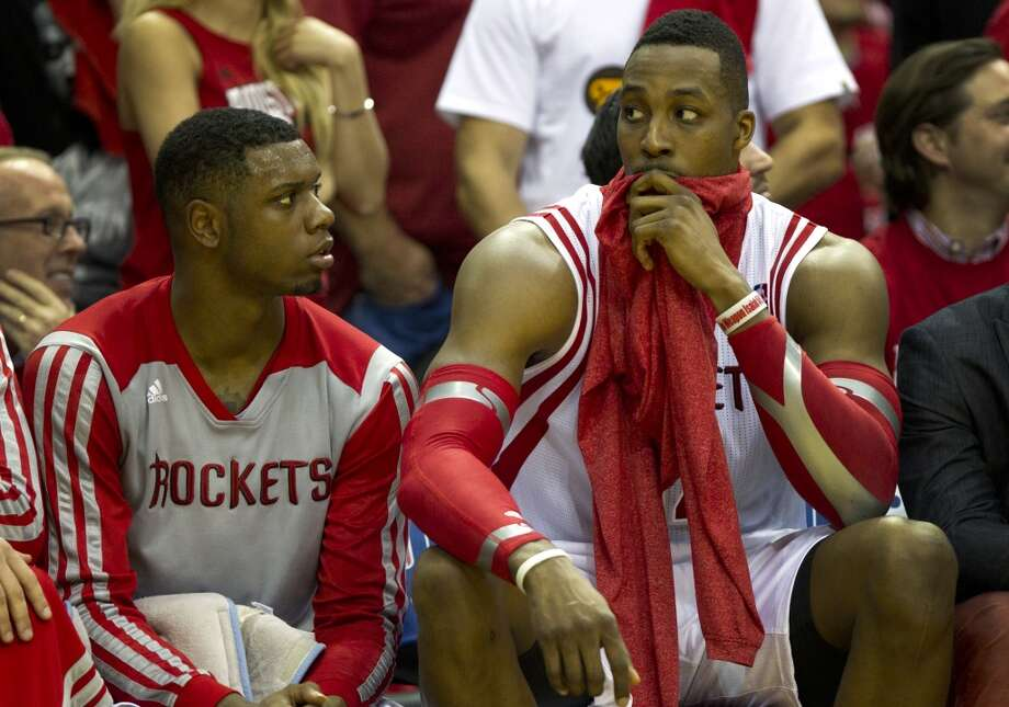Houston Rockets forward Terrence Jones, left, and center Dwight Howard sit on the bench during the fourth quarter of Game 2 of the NBA Western Conference Quarterfinals at Toyota Center Wednesday, April 23, 2014, in Houston. ( Brett Coomer / Houston Chronicle ) Photo: Brett Coomer, Houston Chronicle