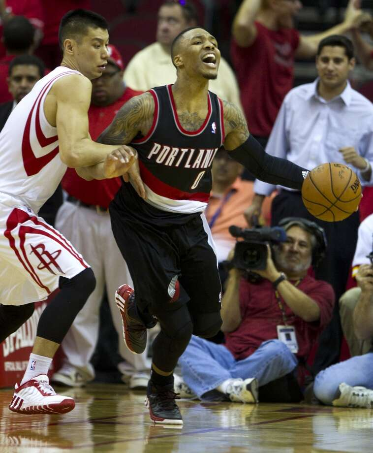 Rockets guard Jeremy Lin, left, fouls Trail Blazers guard Damian Lillard. Photo: Brett Coomer, Houston Chronicle