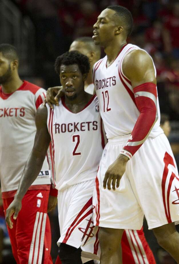 Rockets guard Patrick Beverley (2) and Rockets center Dwight Howard (12) walk off the court during a time out. Photo: Brett Coomer, Houston Chronicle