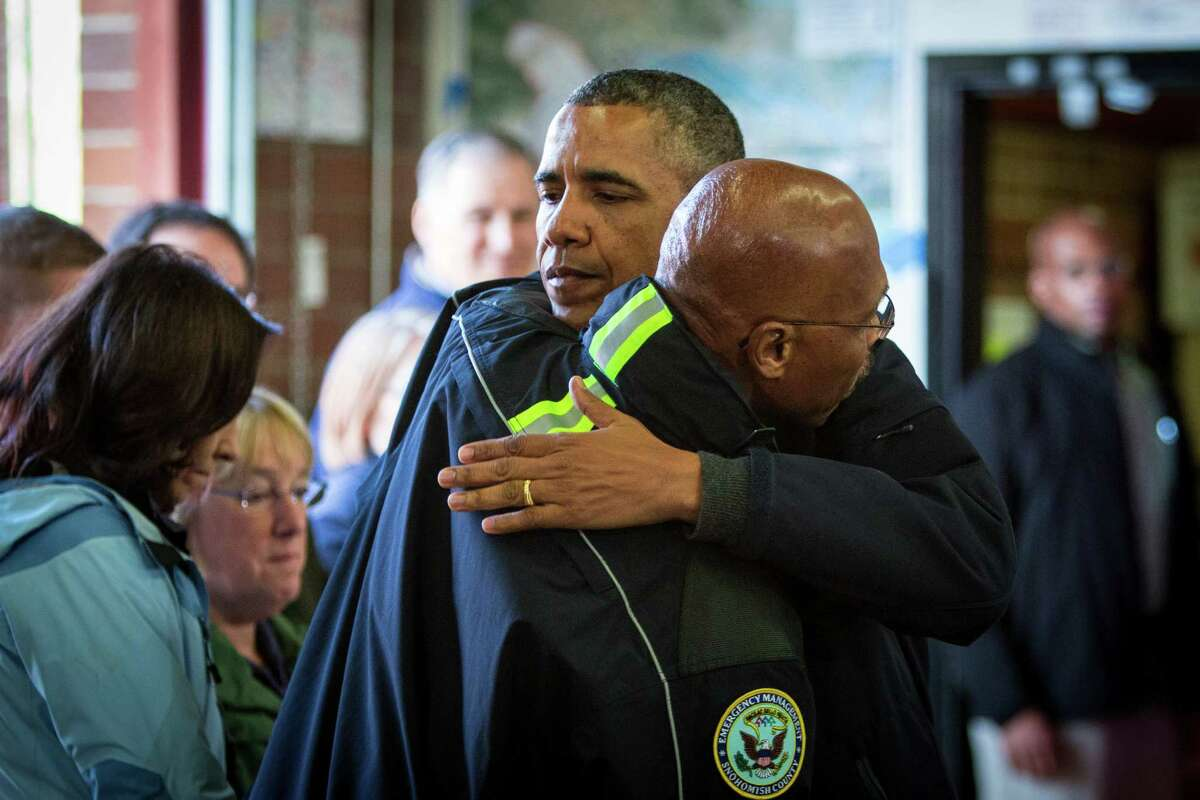 President Barack Obama hugs County Executive John Lovick as Obama visits the Oso Fire Station to speak with rescuers near the scene of last month's deadly Oso mudslide. Photographed on Tuesday, April 22, 2014.