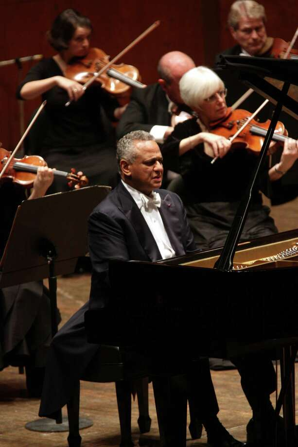"Andre Watts shares the stage with the New York Philharmonic at Avery Fisher Hall Dec. 5, 2012. Here, he plays Rachmaninoff's ""Piano Concerto No. 2."" Watts will perform in Stamford, Conn., on Saturday, April 26, 2014.  (Photo by Hiroyuki Ito/Getty Images) Photo: Contributed Photo / Stamford Advocate Contributed"