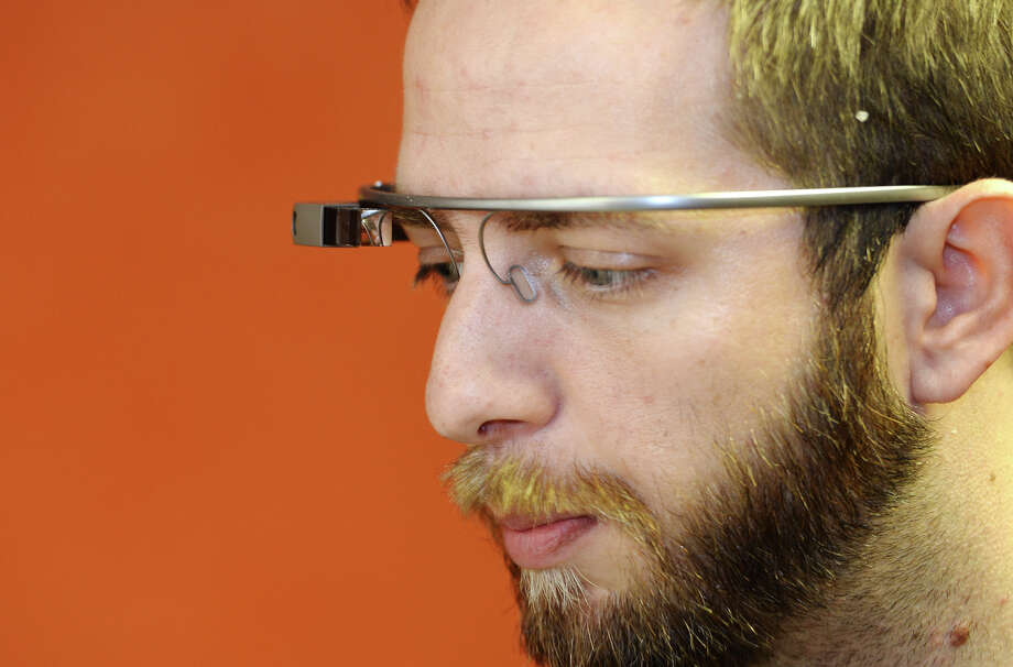 Lance Killian talks about his experience so far with Google Glass. Killian, 30, is a beta tester for Google Glass, the new wearable technology from the tech giant. Photo taken Wednesday, 4/23/14 Jake Daniels/@JakeD_in_SETX Photo: Jake Daniels / ©2014 The Beaumont Enterprise/Jake Daniels