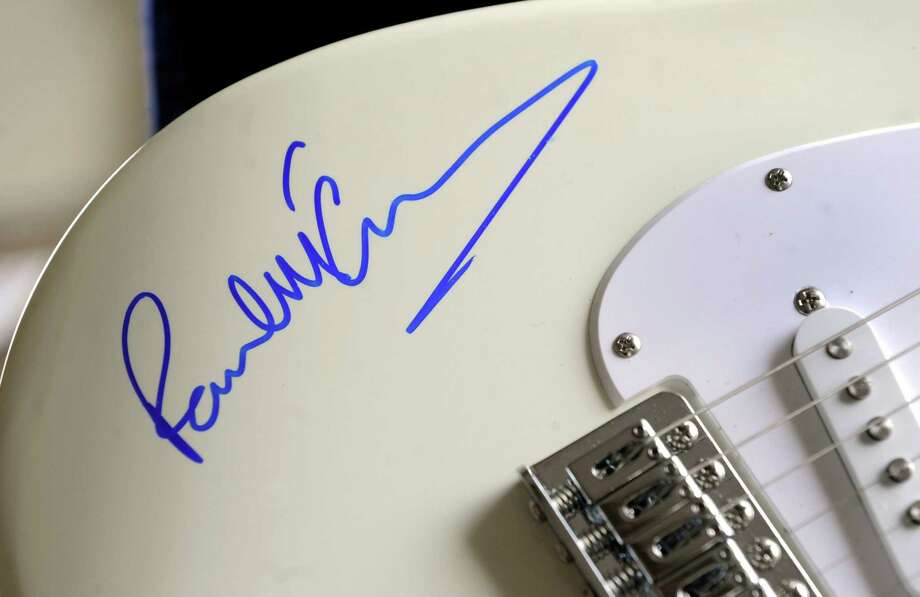 The authenticity of a guitar signed by Paul McCartney has been called into question. The guitar will be part of an annual auction at St. Thomas' Episcopal Church on Greenwood Ave. in Bethel, Conn. on Saturday, May 3, 2014. Photo: Carol Kaliff / The News-Times