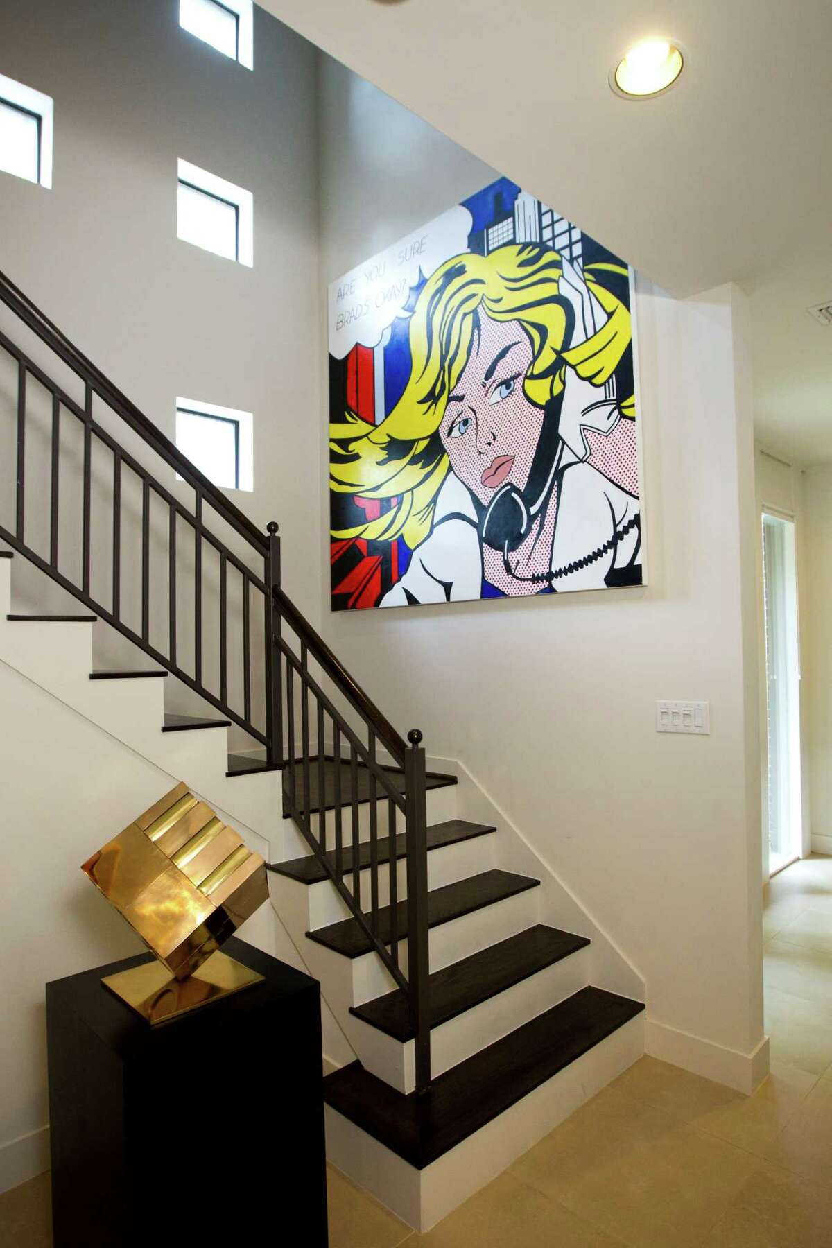 The windows in the stairway show off a Tony Rosenthal sculpture and a reproduction of a Roy Lichtenstein painting.