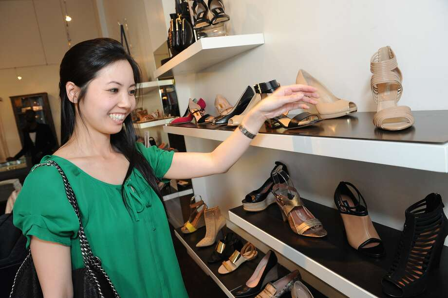 Bay Area boutiques including HeidiSays Shoes, participated in Style Celebrations in honor of the new Style section in the SF Chronicle on April 23, 2014. Vicky Tan is seen shopping. Photo: Susana Bates, Special To The Chronicle