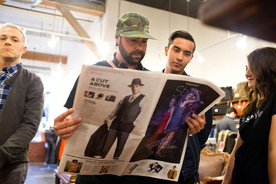 Nick Williams and Jordan Deherrera, of POPGANG, check out the paper at Welcome Stranger during the San Francisco Chronicle Style section relaunch events in Hayes Valley in San Francisco, Calif., Wednesday, April 23, 2014. Photo: Jason Henry, Special To The Chronicle