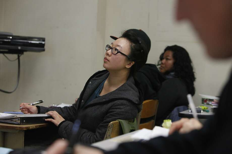 City College of San Francisco student Wendy Liu takes notes during a statistics lecture in San Francisco in February. Photo: Lea Suzuki, The Chronicle