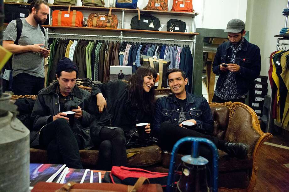 Nicole Stutz, of Marchesa, center, and Jordan Deherrera, of POPGANG, relax on tyne couch at Welcome Stranger during the San Francisco Chronicle Style section relaunch events in Hayes Valley in San Francisco, Calif., Wednesday, April 23, 2014. Photo: Jason Henry, Special To The Chronicle