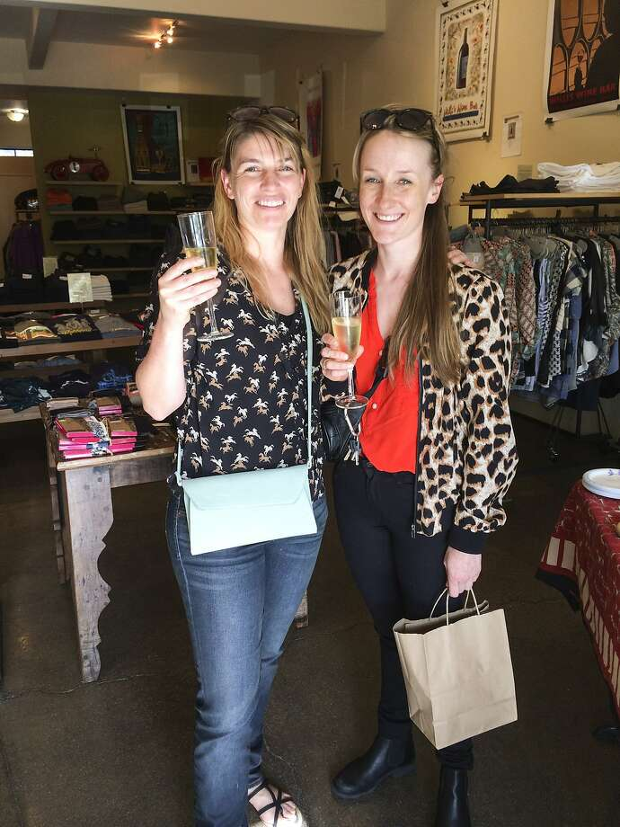Friends Jessica Riquetti and Stine Petersen enjoy champagne while shopping at Convert in Berkeley during the Style Celebrations at Bay Area Boutiques on April 23, 2014. Photo: Yoni Mayeri, Special To The Chronicle