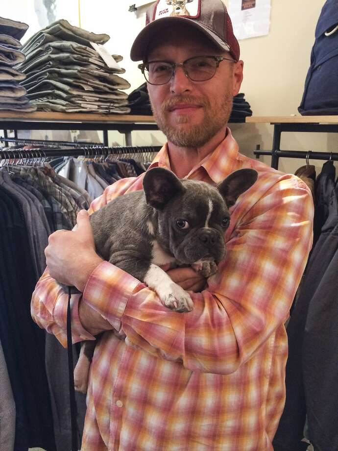 Randall Baxter and Kali, the 3-month-old French Bulldog he is caring for shopping at Convert in Berkeley during the Style Celebrations at Bay Area Boutiques on April 23, 2014. Photo: Yoni Mayeri, Special To The Chronicle