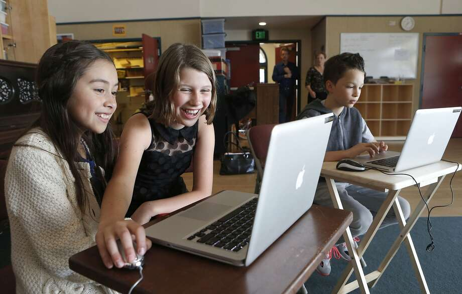 Students Nayeli Rodriguez (left) and Sasha Hopewell explore the S.F. Symphony's redesigned SFSKids website, below. Photo: Michael Macor, The Chronicle