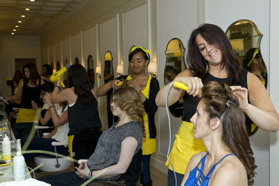 Brittany Paz (right) gives Rachael McClure a blow dry while working at Drybar during a Style Launch event to celebrate the San Francisco Chronicle's newly reimagined Style section at the salon in San Francisco, Calif., on Wednesday, April 23, 2014. Photo: Laura Morton, Special To The Chronicle