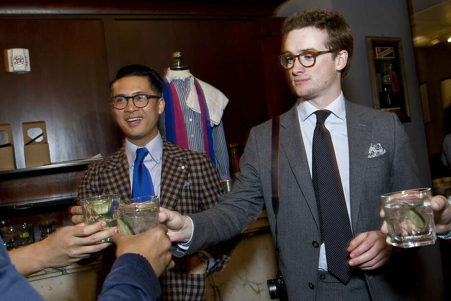 Alan Maramag (left) and Ian Anderson enjoy cocktails with friends during the Style Launch event at Wingtip to celebrate the San Francisco Chronicle's newly reimagined Style section at the store in San Francisco, Calif., on Wednesday, April 23, 2014. Photo: Laura Morton, Special To The Chronicle