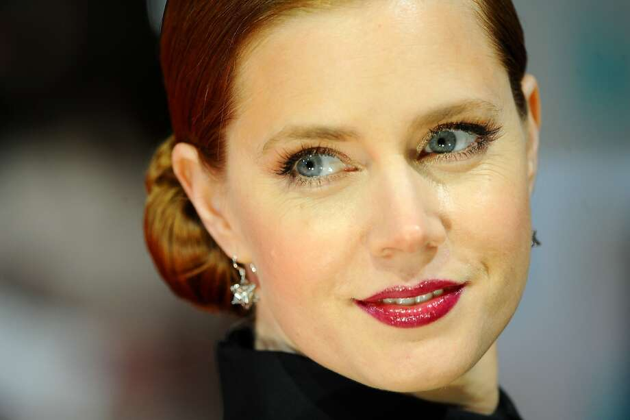 """Amy Adams, actress:Adams is """"the cinematic chameleon,"""" says Time. Fellow actress Emily Blunt writes, """"She's silly and funny and dirty. And she's incredibly honest. She's self-admittedly terrible at small talk and hiding her feelings, which I really admire in an industry full of gush."""" Photo: Anthony Harvey, Getty Images"""