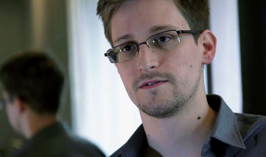 "Edward Snowden,  leaker of classified U.S. information: Snowden is ""the renegade in exile,"" says Time. ""Edward Snowden's story is one of choices,"" writes guest profiler Daniel Domscheit-Berg, a former spokesman for WikiLeaks. ""He is said to be a computer genius, but he has chosen to do what is right rather than what will enrich him, and he has chosen to do what is right rather than what is lawful."" Photo: Uncredited, AP / The Guardian"