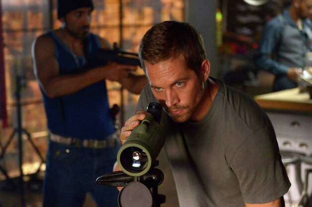 "Paul Walker plays a police officer who must find and disarm a neutron bomb in ""Brick Mansions."" Photo: Philippe Bosse, HOEP / Relativity Media"