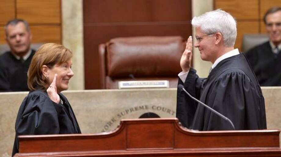 State Supreme Court Justice Michael Lynch is sworn in by Presiding Judge Karen Peters as one of three new members of the Appellate DIvision in Albany. (Skip Dickstein / Times Union)