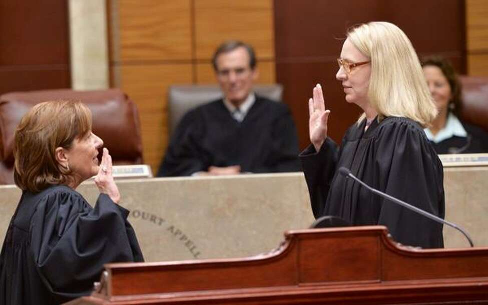 State Supreme Court Justice Christine Clark, right, is sworn in by Presiding Judge Karen Peters as one of three new members of the Appellate DIvision in Albany. (Skip Dickstein / Times Union)