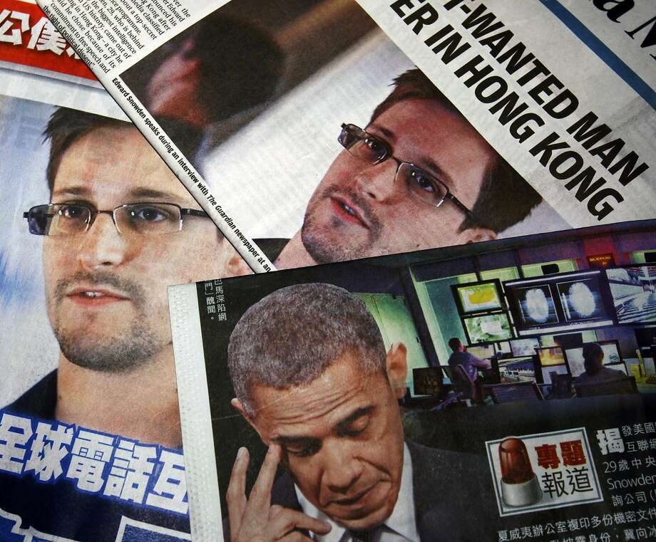 Photos of Edward Snowden, a contractor at the U.S. National Security Agency (NSA), and U.S. President Barack Obama are printed on the front pages of local English and Chinese newspapers in Hong Kong in this file illustration photo taken on June 11, 2013. To match Special Report UKRAINE-PUTIN/DIPLOMACY                            REUTERS/Bobby Yip/Files (CHINA - Tags: POLITICS MEDIA) Photo: Bobby Yip, Reuters