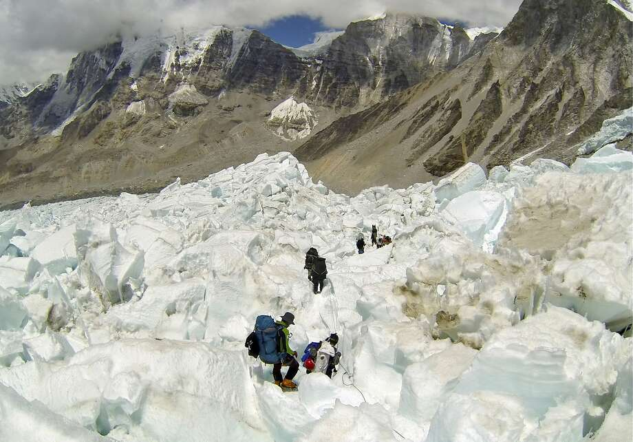 The Discovery network will ask documentary viewers to donate to a fund for the families of the Mount Everest Sherpa guides. Photo: Pasang Geljen Sherpa, Associated Press